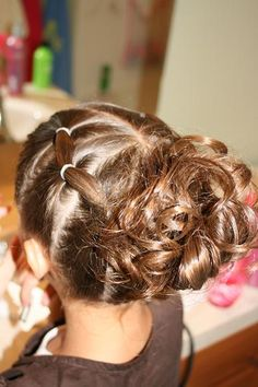 Puff braids into messy bun