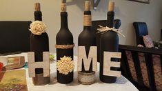 Un set de 4 bouteilles décoratives « HOME » de couleurs noirs avec une décoration en jute, fleurs Off white. Decoration, Jute, Wine Rack, Bottle, Home Decor, Decorative Bottles, Black Colors, Flowers, Decorate Bottles