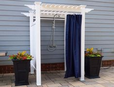 Take your outdoor room to the next level with this decorative yet practical vinyl Oceanside Outdoor Shower. Whether you want to rinse off the sand from the beach or the chlorine from the pool, this shower enclosure will enhance your backyard. Outdoor Decor, Outdoor Bathrooms, Outdoor Space, Outdoor Rooms, Outdoor Shower, Outdoor Pool Decor, Outdoor Pool Shower, Outdoor Shower Enclosure, Pool Shower