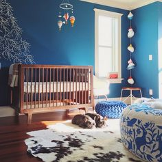 Oeuf Sparrow Crib in Walnut.  http://www.oeufnyc.com/index.php/furniture/sparrow-crib.html