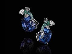 Explore Tiffany & Co.'s High Jewelry. One-of-a-kind, iconic pieces from Tiffany & Co. Tiffany & Co., Tanzanite Earrings, Platinum Earrings, Tiffany Jewelry, Tiffany Earrings, Blue Books, High Jewelry, Animal Jewelry, Stone Earrings