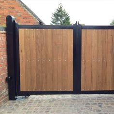 Bespoke metal wood lined driveway gates from Ironcraft. Bespoke designs and made to measure for each property - in traditional or contemporary styles. Front Gate Design, Main Gate Design, House Gate Design, Door Design, Wooden Garden Gate, Wooden Gates, Wooden Electric Gates, Wooden Gate Designs, Metal Driveway Gates