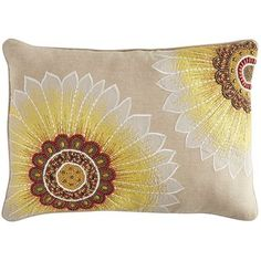 Vibrant, strong and ruggedly beautiful, sunflowers seem to just make you smile. And our intricately beaded and stitched pillow, blooming with bold sunflowers, will bring smiles to your sofa. A neutral backdrop lets these artful beauties pop.