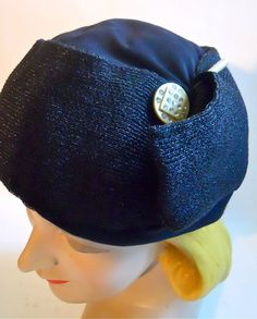Black sisal and satin 1930s hat with deco styling and rhinestone celluloid accent at side. No flaws, sz 21 1/2.    $155