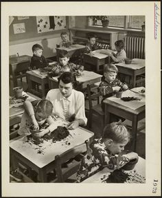 Primary school students planting flower bulbs in a classroom Ottawa, Ontario, 1923 [Malak Karsh]
