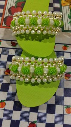 Green and white beads on flip flops