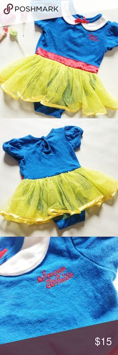"""Snow White Onesie Costume Snow White Baby Halloween Costume Onesie in blue, yellow and red.  Just add tights and sparkly princess shoes for baby's first Halloween!  Pre-loved but in great condition.  Slight stain on collar and small hole on back shoulder, see pic.  Signs of normal wash and wear.  Size 6-9 months.  Measurements laying flat: Armpit to armpit: 9"""" Waist (across): 19"""" Total length: 15.5"""" Disney Costumes"""