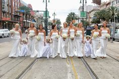White wedding | Bridesmaids dresses | Canal Street Photography | New Orleans Wedding Planner - It's Your Time Events: New Orleans Wedding: Jamie & Pierce | Sweet Loverly | Sparkles on her dress | Trees at a reception | Bougainvillea