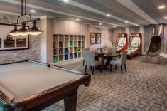 Contemporary Game Room Decorations with Arcade Games and an Awesome slide entrance