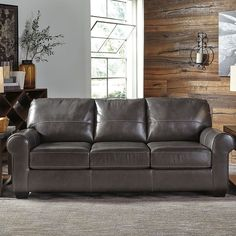 That Furniture Outlet - Minnesota's #1 Furniture Outlet. We have exceptionally low everyday prices in a very relaxed shopping atmosphere. Ashley Canterelli Gunmetal Leather Sofa thatfurnitureoutlet.com #thatfurnitureoutlet  #thatfurniture  High Quality. Terrific Selection. Exceptional Prices.