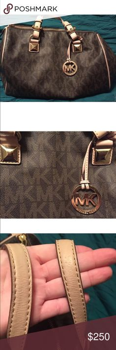 Michale Kors Purse MK logo authentic purse. Some stains on inside. Very little wear. Michael Kors Bags
