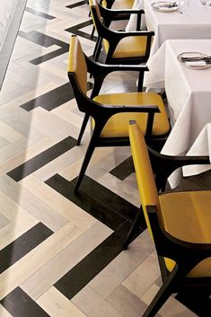 a luxury design dining chair from Okha design , sharp clean lines make this dining chair a thing of beauty, the dark wood in contrast with the yellow leather upholstery adds a modern dynamic look and feel to this comfy dining chair....