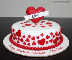 Love theme customized designer fondant cake with 3D big heart topper for wife's birthday