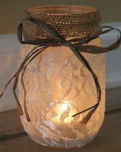 Professional-looking DIY mason jar luminary. The burlap and twine / ribbon around the top polish off the lace look. There's a tea light insight. (Maybe purple bow for my wedding centerpieces) Fall Wedding, Diy Wedding, Dream Wedding, Wedding Flowers, Wedding Rustic, Trendy Wedding, Rustic Weddings, Wedding Shoes, Decor Wedding