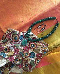 Silk cotton saree with a handpainted kalamkari blouse and silver jewellery. #ootd #saree