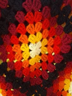 Try this with greens/blues. The 'Firestarter' Blanket! Notes; I used a basic granny square pattern - 8ply yarn, can't remember what size hook. Colour progression; Light Yellow Bright Yellow Orange Red Dark Red Black Squares joined in black yarn, single crochet.