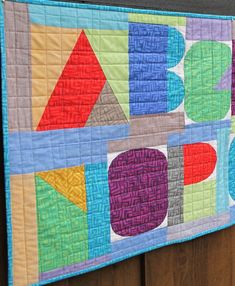 Close-up of I Spy The Alphabet pattern by Terri Carpenter in a banner format sewn by Carol Van Zandt