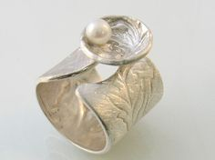 Pearl in a Shell satin open band silver ring with pearl by yutal, $140.00