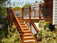 This composite deck has wooden rails and toe kicks on the steps, which were cleaned and sealed by See Dirt Run Inc.