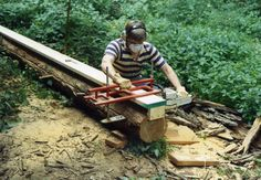 Chainsaw Mill by Ed Hollingsworth -- Homemade chainsaw mill fabricated from square tubing, threaded rod, and hardware. Mill glides along a preinstalled flat wooden rail. http://www.homemadetools.net/homemade-chainsaw-mill-3