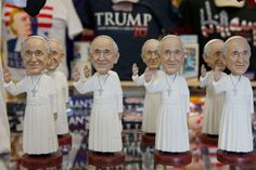 Pope Francis dolls for sale in Washington next to products for Donald J. Trump, an emblem of some qualities the pope criticizes. (Photo: Andrew Caballero-Reynolds/Agence France-Presse — Getty Images)