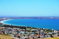 Saldanha - beach area as well as the northeast section of the town. The iron ore loading facility as well as the oil rig service station is visible on the other side of Langebaan lagoon. Sa Tourism, Iron Ore, Oil Rig, Coastal Homes, Countries Of The World, Homeland, West Coast, South Africa, Cape