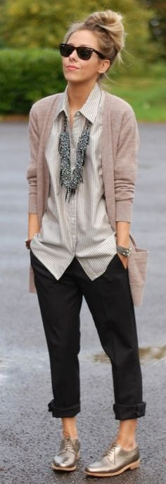 Eclectic long, chunky, necklace and coordinated cluster of bangles styled with men's style collared shirt, cropped pants, and open slouchy cardigan.