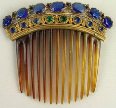 Victorian tortoiseshell back comb with blue and green paste stones.