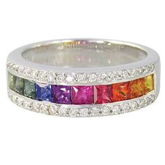 I would love this to be my engagement ring! Rainbow Sapphires and diamond along the top and bottom! :) From Etsy!