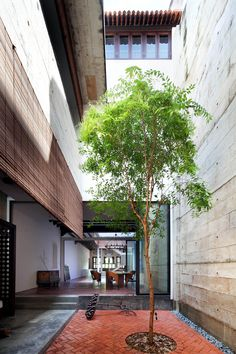 Built by ONG&ONG Pte Ltd in , Singapore with date 2013. Images by See Chee Keong. Located within a conservation district, this home celebrates the traditional charm of Peranakan shophouses with the a...
