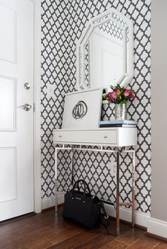 LOVE!!! glamorous entryway, graphic wallpaper, gray and white wallpaper, white lacquer console, small foyer, small entrance, glam entrance, white bamboo mirror