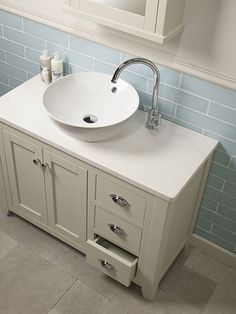 We love this Marlborough unit with worktop & ceramic sit on basin by Laura Ashley bathrooms #bathroomdesign #washstand