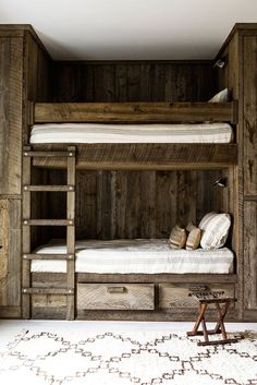 Soft, striped Libeco linens complement the rustic texture in the kids' bunk bed room.