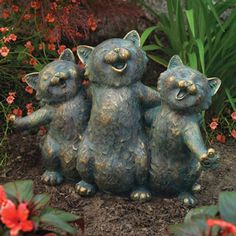 Three happy feline friends belt out a tune only they can hear in this adorable and uplifting statue. The detailed polyresin design adds a trio of smiles to any garden, yard or porch and is finished in a weathered verdigris style. 10-1/2 x 15.
