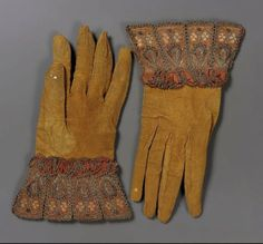 Pair of gloves        English, 1575–1625         England  Dimensions      L (left): 0.24 m L (right): 0.23 m W (top of gauntlet): 0.14 m  Medium or Technique      Leather; embroidered with silk and metallic threads; metallic bobbin lace; woven silk and metallic ribbon