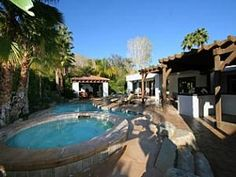 This private Palm Springs mini-estate sits on a beautifully landscaped property. Enter through a wall of privacy hedges in to the meticulously manicured courtyard. This nearly 4,700 square foot home w...