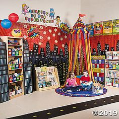 Get inspired with these Reading Corner Ideas from Oriental Trading. Find the Reading Corner Theme your students will love and create a space where they will love to read. Book Corner Eyfs, Reading Corner School, Book Corner Display, Book Corner Classroom, Preschool Reading Corner, Reading Corner Classroom, Reading Display, Writing Corner, Book Corner Ideas Preschool