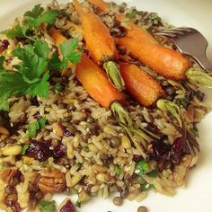 Amazing recipe I cooked up from p 133 of the #ancientgrains cookbook - the base is brown rice, grey lentils, almonds (I added some pine nuts too), dried cranberries and chopped parsley. Topped with roasted baby carrots. Dee-vine!