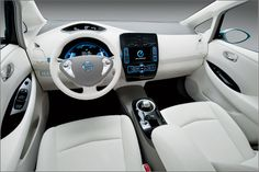 Nissan Leaf Interior. The seats are made from recycled plastic bottles and it produces O emissions.