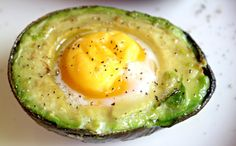 Everyone gets bored with breakfast. I call this one Baked Egg in Avocado!