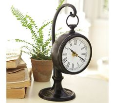 Reminiscent of vintage train station clocks, our bedside clock is crafted of steel in a dark bronze finish.