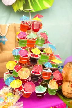 Jelly (or jelly shots) with mini umbrella picks in a cupcake stand! Great desert idea when it's too hot for chocolate or cake!