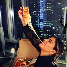 The Very Best Celebrity Food Photos of the Week | NICOLE SCHERZINGER | Say cheese! The singer rewarded herself after a show in N.Y.C. with an extra-cheesy slice.