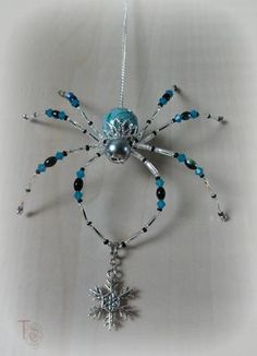SOLD - I have many other beautiful spiders available in my shop, or I can make you one similar to Stormy; Christmas Spider Legend Stormy is a gorgeous inch beaded Christmas spider that shimmers and shines and cant wait to be part of your home décor. Beaded Crafts, Wire Crafts, Jewelry Crafts, Wire Jewelry, Beaded Jewelry, Jewelery, Handmade Jewelry, Jewellery Box, Damas Jewellery