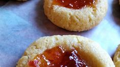 Cheddar thumbprint cookies are filled with hot pepper jelly for a savory appetizer for your next party.