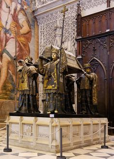 Grave Marker- Tomb of Christopher Columbus (Cristóbal Colón) in the Cathedral in Sevilla. The remains are borne by kings of Castile, Leon, Aragon and Navarre Christoph Kolumbus, Famous Graves, Seville Spain, Barcelona Spain, Dominican Republic, Spain Travel, Places Around The World, Cemetery, Medieval