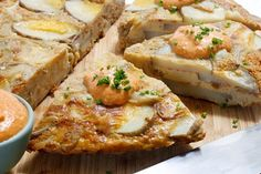 Roasted garlic, onions and cauliflower are what boost the flavours of this tasty and simple dish. The recipe is a lighter version of a Spanish tortilla. You can bake the omelette in any casserole dish that is roughly 8 by 12 and it will turn out great.