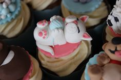 Fondant cat cupcake topper for a cats and dogs party.