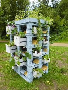 pallets and crates as a planter tower | vertical herb garden