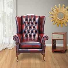 A high back armchair designed to relax your body, this Chesterfield Mallory wing chair is special for its rich antique Oxblood leather. International delivery.